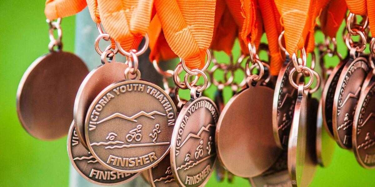 Victoria Youth Triathlon awards hanging down.